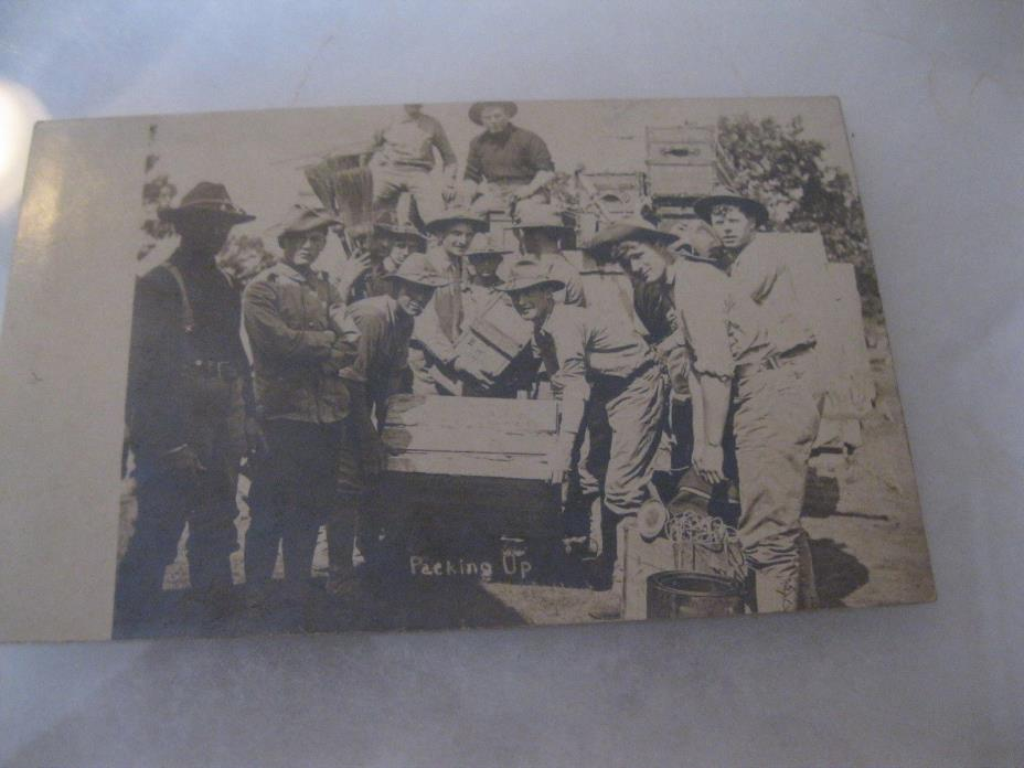 WWI Soldiers Packing a truck to go home Postcard 1918 RPPC