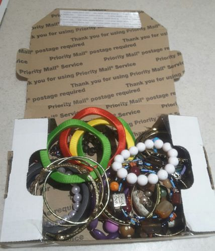 Box full of 30 plus Bracelets Many types  beaded, wood, glass, plastic, must see