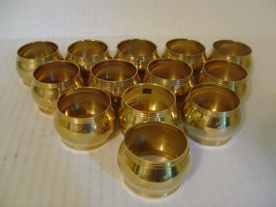 SET OF THIRTEEN SOLID BRASS NAPKIN RINGS