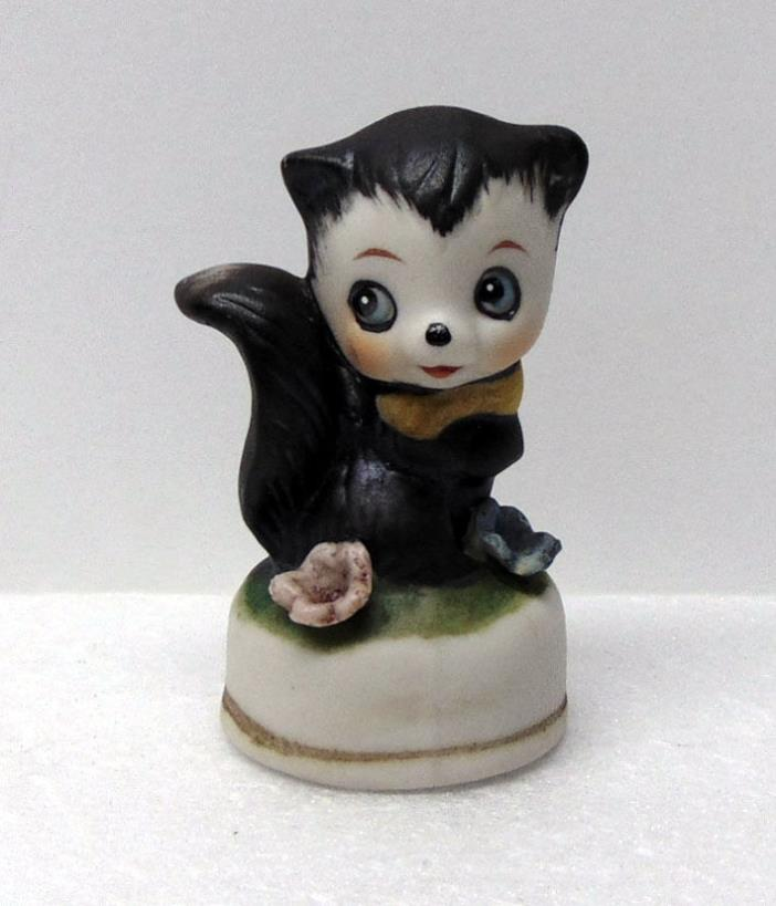 Skunk Figurine on Base with Flowers, Porcelain, Only 2¾