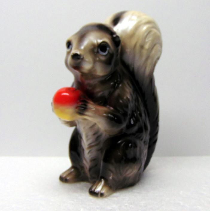 Skunk with Apple Figurine, Ceramic, 7¾