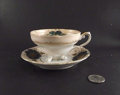 WHITE GREEN GOLD THREE FOOTED SHAFFORD CABINET TEA CUP AND SAUCER