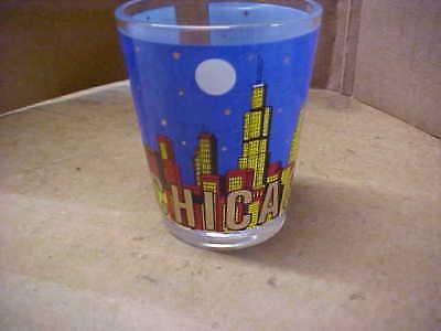 SHOT GLASS = CHICAGO - BLUE W / MULTI-COLOR SLYLINE - USED = NO CRACKS OR CHIPS