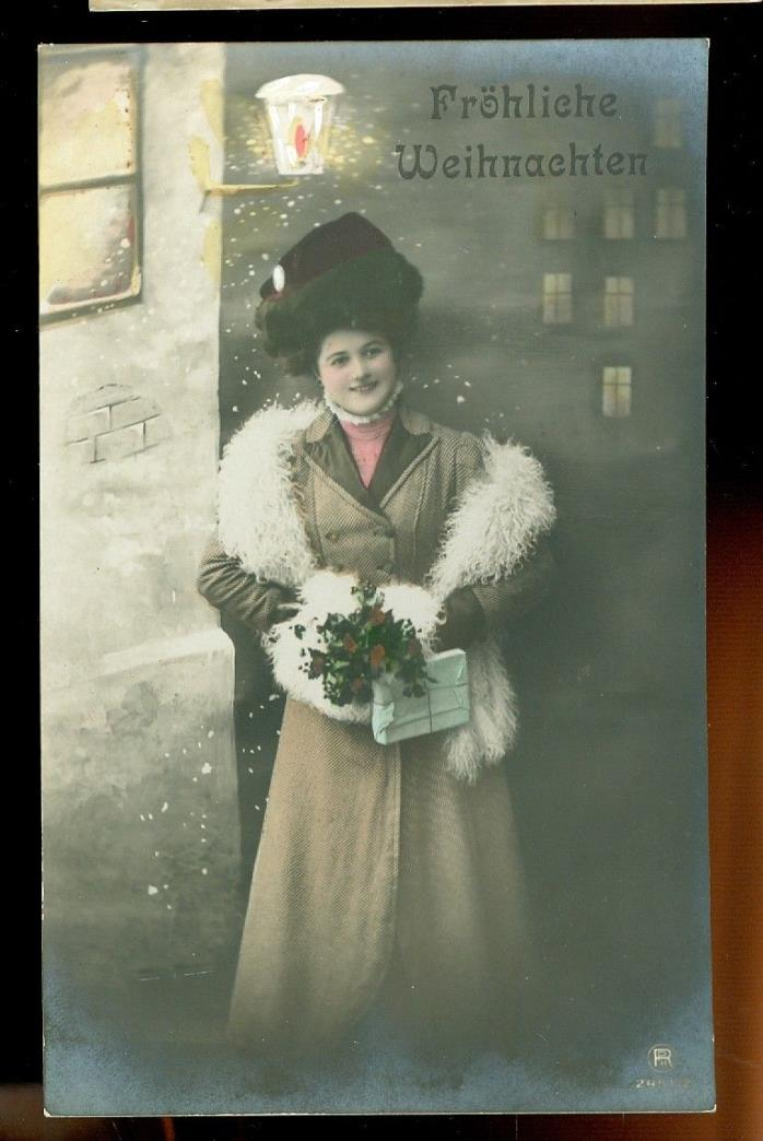 card looks like a Photograph-woman-standing on street corner with gift-