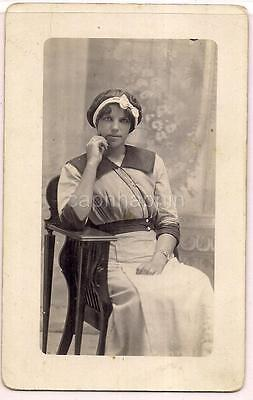 Hair Net Maid Uniform Looking Woman In Chair Antique 1910s Real Photo Postcard
