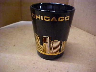 SHOT GLASS = CHICAGO - BLACK W / GOLD SLYLINE - USED = NO CRACKS OR CHIPS