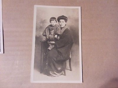 VINTAGE PHOTO POSTCARD - ASIAN WOMAN WITH CHILD