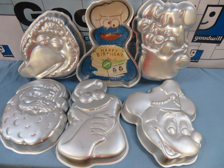 Lot of 6 VTG WILTON Cake Pans Cookie Monster, Popple, Big Bird, Mickey, Santa