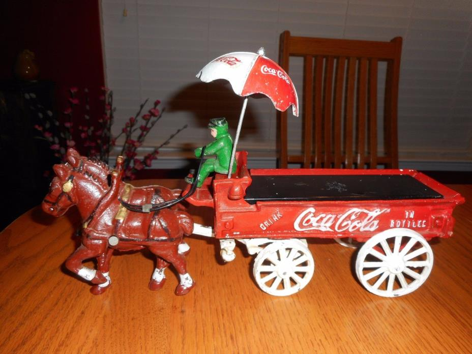 Vintage Coca Cola CAST IRON Horse Drawn Wagon With Umbrella
