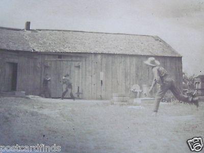 RPPC CHILDREN PLAYING STICKBALL IN BARN YARD! c.1907 REAL ARTURA PHOTO POSTCARD