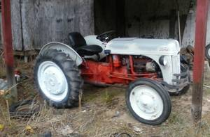 9 n ford tractor sell or trade $1.800 (heard co.)