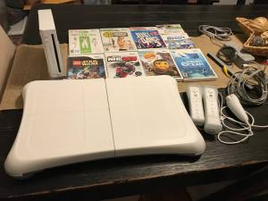 Wii gaming console with balance board and games (Merion Village)
