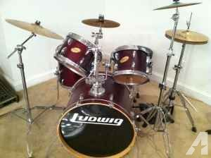 Ludwig red wine drum kit with roto toms and spare heads - $725 (1401 Leigh