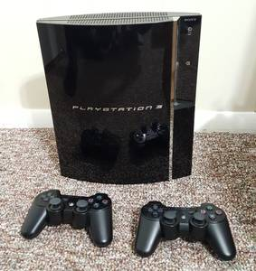 PS3 console (80Gb fat) with 2 wireless controlers (White Marsh)