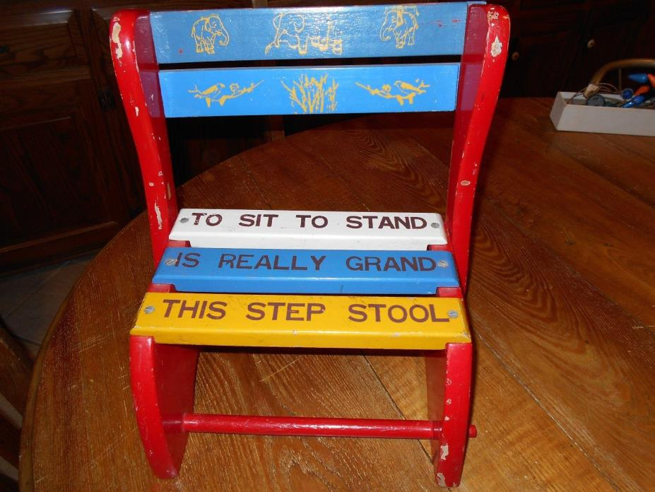 A CHILD WOODEN STOOL IT VERY NICE LD ONE
