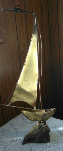 vintage hammered copper sailboat with wooden base