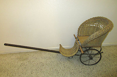 antique wicker doll carriage/buggy
