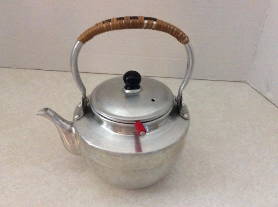 Vintage aluminum teapot, infuser and wicker handle