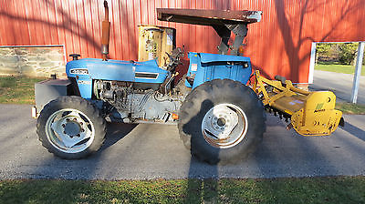 NEW HOLLAND 4630 4X4 UTILITY TRACTOR W/ BOOM AND REAR FLAIL MOWERS 940 HOURS!