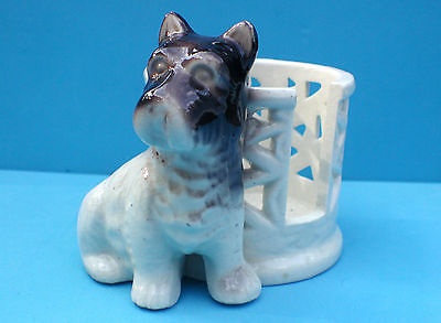 Vintage Scottie dog figurine planter or coaster holder ?