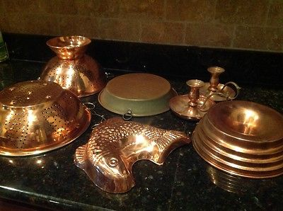 copper colanders, pie pan, molds and candlesticks