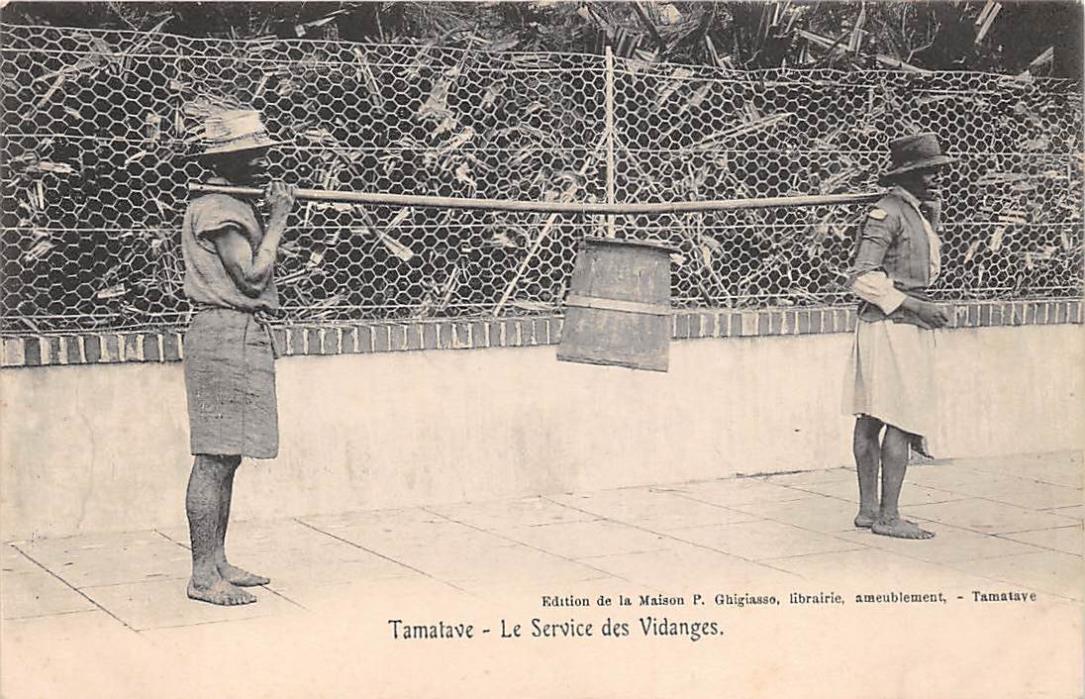 TAMATAVE, MADAGASCAR, 2 MEN HAULING AWAY A LIQUID WASTE CONTAINER c. 1904-14