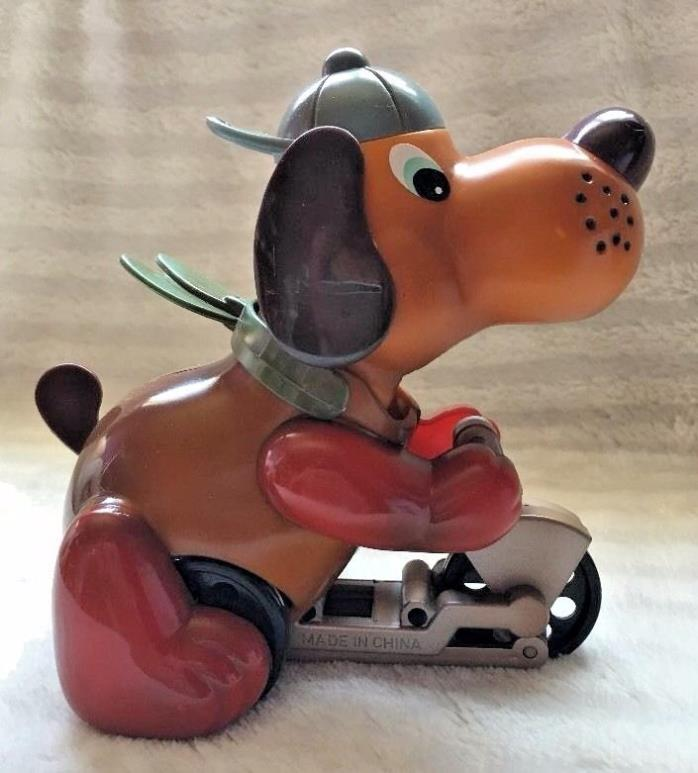 VINTAGE RUSS DOG ON BIKE WIND UP ROLLS & BELLS RING NEW IN BOX
