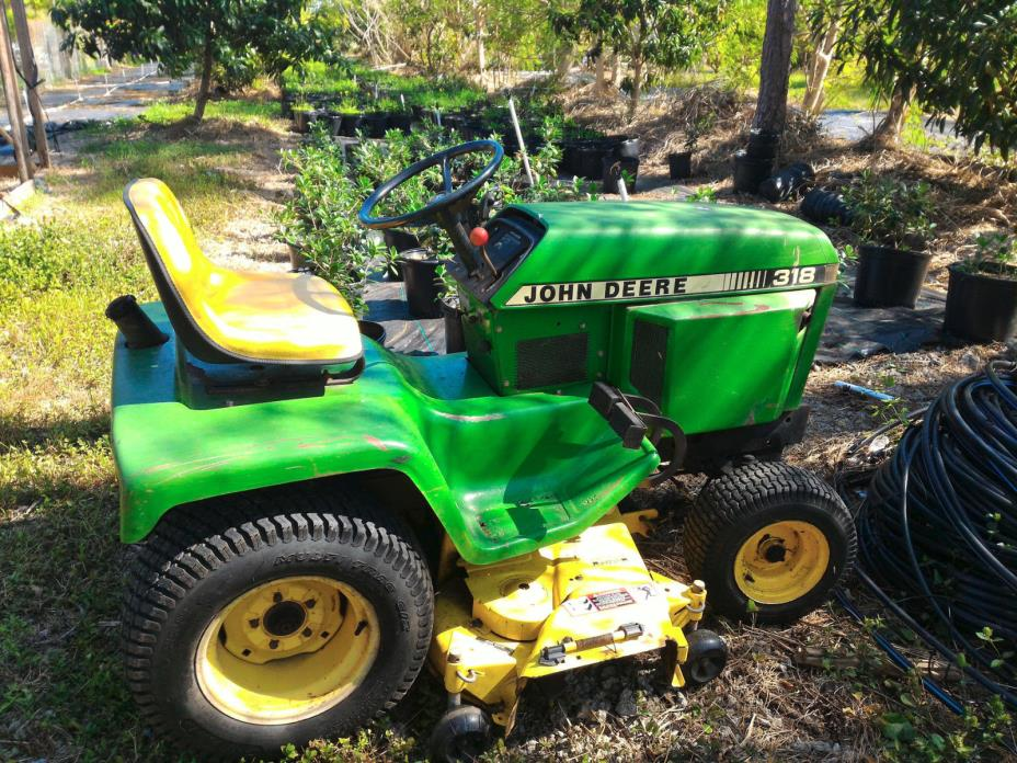John Deere 318 Garden Tractor Riding Mower with Mid Mounted 48 inch Mowing Deck