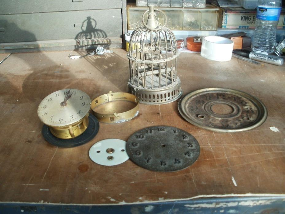 LARGE LOT OF ANTIQUE  CLOCK  PARTS AND A BIRD CAGE