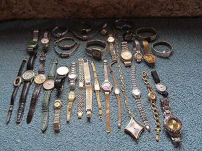 assortment of men and women's watches