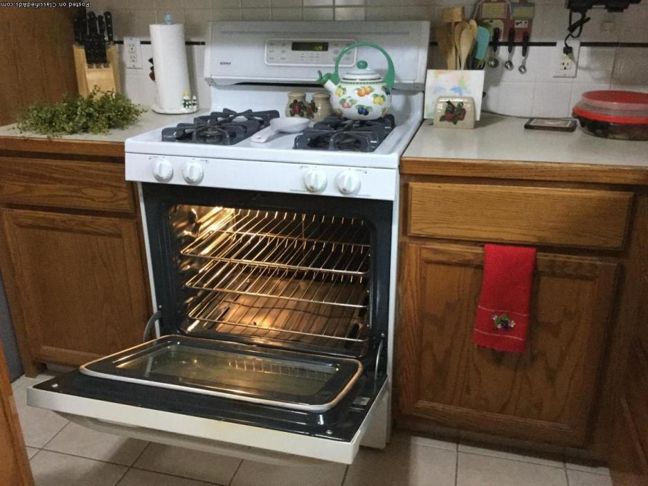 Like new White,self- cleaning, Gas Range with over the top, new microwave.