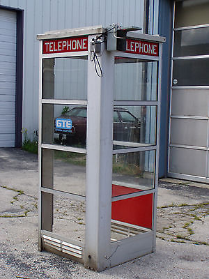 old antique metal phone telephone booth superman style