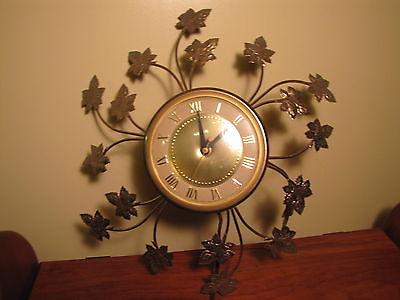 Midcentury modern metal leaf united wall clock