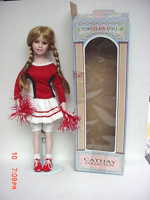 CATHAY COLLECTION PORCELAIN RED & WHITE CHEER LEADER DOLL