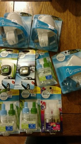 New in package lot of 9 febreze noticeables warmers,and car vents