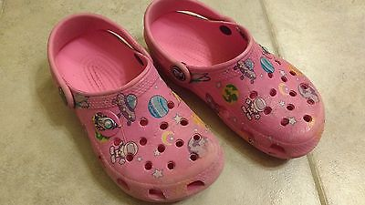 Children's pink crocs size 10/11. GUC! planets design