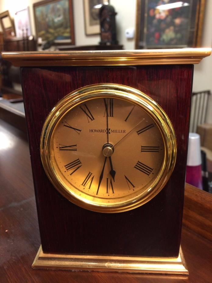 Howard Miller Mahogany Mantle Clock at The Raleigh Furniture Gallery