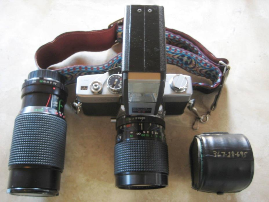 MINOLTA SR-T100 35MM CAMERA & (2) SUPER ALBINAR ZOOM LENS 80-205MM-28-80MM
