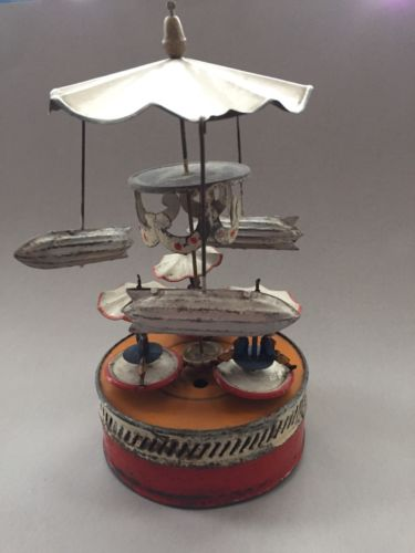 Tin Toy Carrousel With Zeppelins/Penny Riders.Made By Gunthermann/Germany/1920s