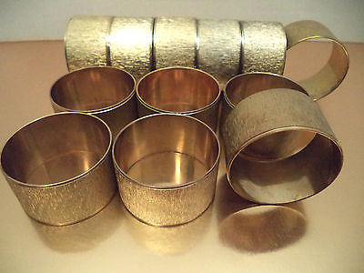 Set of 12 Vintage Hollywood Regency gold brass chiseled napkin rings 1
