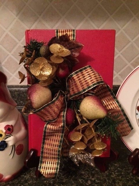 HOLIDAY DECOR VINTAGE BOOK TRIMMED WITH PLAID RIBBON, SILK FRUIT/GREENERY