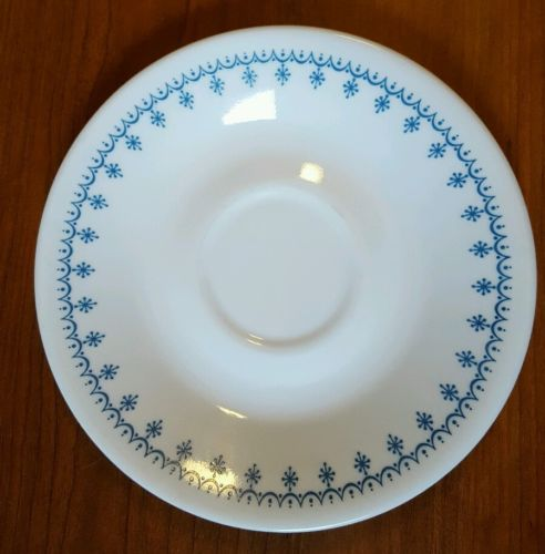 8-Piece White and Blue Decorated Saucers