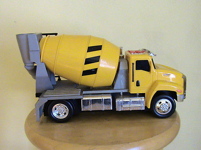 TOY CEMENT MIXER TRUCK USES 3 AA BATTERIES. THE TRUCK MOVES FORWARD, BACK, TURNS