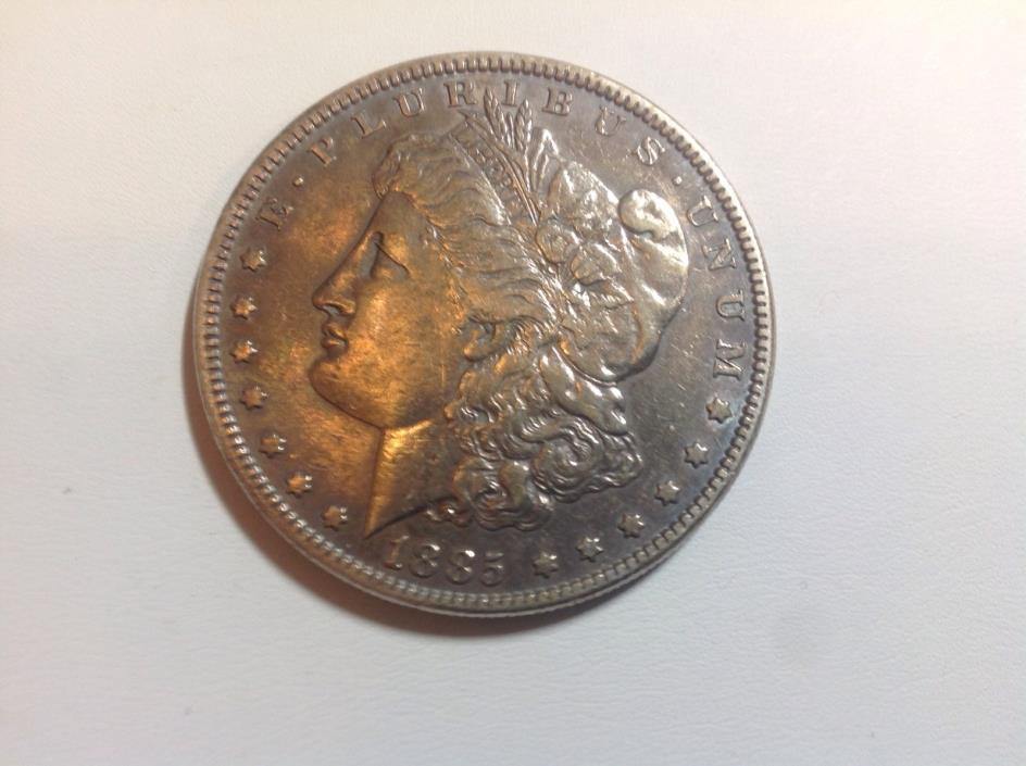 1885 AU Toned  Morgan Silver Dollar