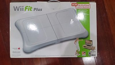 Wii Fit Plus balance board, relatively new, includes Wii Resort/Sport games