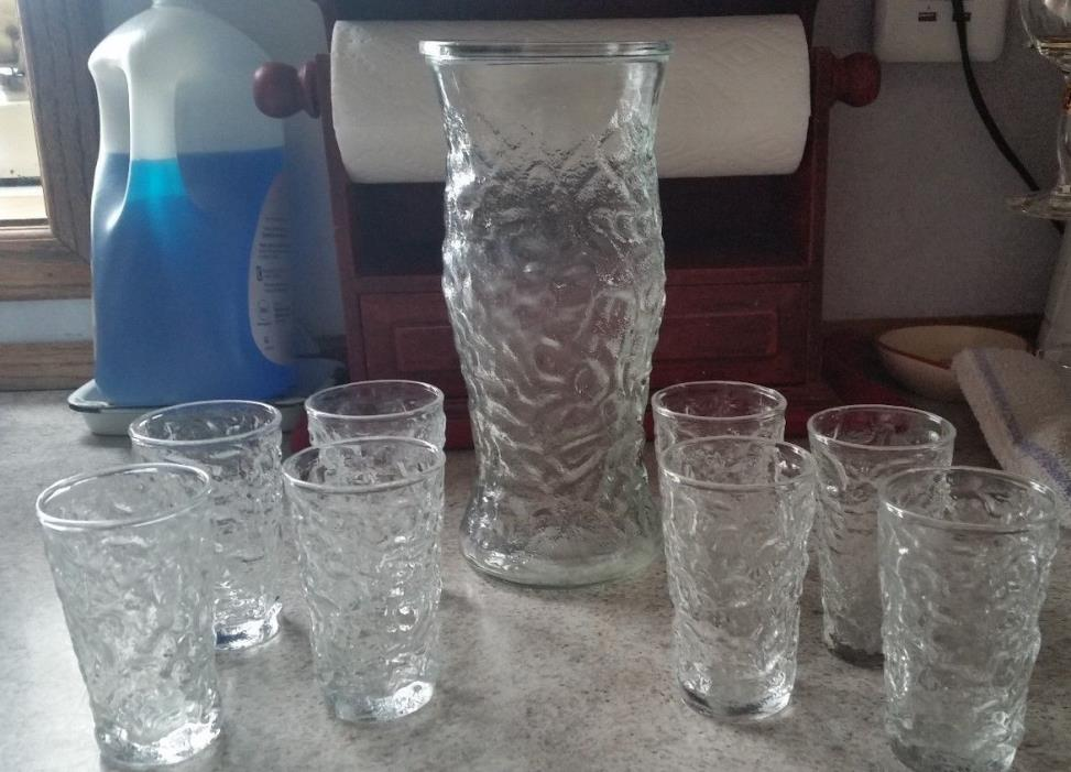 8 juice glasses with pitcher.