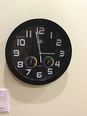 quartz round black wall clock