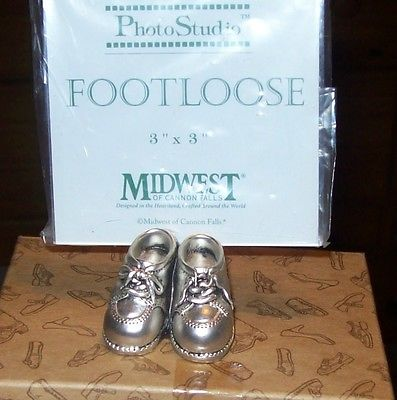 footloose photo studio frame with pewter baby shoes