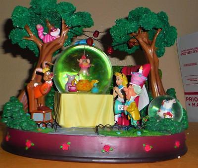 Disney Alice in wonderland Tea party unbirthday snowglobe