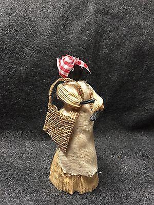 One black vintage corn husk doll